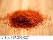 Купить «cayenne pepper or paprika powder on wood», фото № 24208027, снято 13 октября 2016 г. (c) Syda Productions / Фотобанк Лори