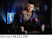 Купить «wizard brews a potion», фото № 24213339, снято 12 октября 2016 г. (c) Майя Крученкова / Фотобанк Лори