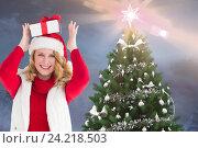 Купить «Happy woman in santa hat holding christmas gift on her head», фото № 24218503, снято 20 марта 2019 г. (c) Wavebreak Media / Фотобанк Лори