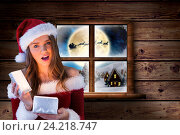 Купить «Surprised woman in santa costume holding at christmas gift», фото № 24218747, снято 22 марта 2019 г. (c) Wavebreak Media / Фотобанк Лори