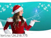 Купить «Beautiful woman in santa costume gesturing agianst digitaly generated background», фото № 24218775, снято 20 марта 2019 г. (c) Wavebreak Media / Фотобанк Лори