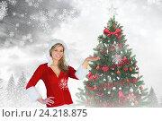 Купить «Beautiful woman in santa costume gesturing against digitally generated background», фото № 24218875, снято 20 марта 2019 г. (c) Wavebreak Media / Фотобанк Лори