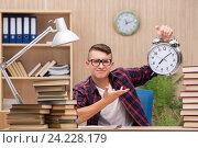 Купить «Young student preparing for school exams», фото № 24228179, снято 30 июля 2016 г. (c) Elnur / Фотобанк Лори