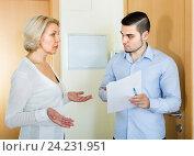 Купить «Serious man and housewife at the door», фото № 24231951, снято 16 октября 2018 г. (c) Яков Филимонов / Фотобанк Лори