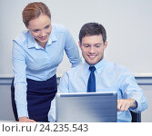 smiling businesspeople with laptop in office, фото № 24235543, снято 25 октября 2014 г. (c) Syda Productions / Фотобанк Лори