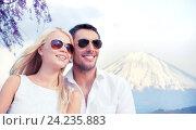 Купить «happy couple over fuji mountain in japan», фото № 24235883, снято 14 июля 2013 г. (c) Syda Productions / Фотобанк Лори