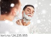 Купить «man shaving beard with razor blade at bathroom», фото № 24235955, снято 15 января 2016 г. (c) Syda Productions / Фотобанк Лори