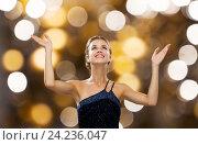Купить «smiling woman raising hands and looking up», фото № 24236047, снято 1 июня 2014 г. (c) Syda Productions / Фотобанк Лори