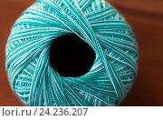 Купить «close up of turquoise knitting yarn ball on wood», фото № 24236207, снято 20 октября 2016 г. (c) Syda Productions / Фотобанк Лори
