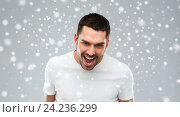 Купить «angry man shouting over snow background», фото № 24236299, снято 15 января 2016 г. (c) Syda Productions / Фотобанк Лори