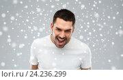 Купить «angry man shouting over snow background», фото № 24236299, снято 15 января 2016 г. (c) Syda Productions / Фотобанк Лори