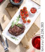 Купить «Стейк из говядины на блюде», фото № 24236383, снято 21 мая 2019 г. (c) Максим Стриганов / Фотобанк Лори