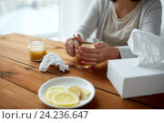 Купить «ill woman drinking tea with lemon and honey», фото № 24236647, снято 13 октября 2016 г. (c) Syda Productions / Фотобанк Лори