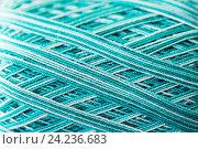 Купить «close up of turquoise knitting yarn ball», фото № 24236683, снято 20 октября 2016 г. (c) Syda Productions / Фотобанк Лори