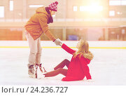 Купить «man helping women to rise up on skating rink», фото № 24236727, снято 26 ноября 2014 г. (c) Syda Productions / Фотобанк Лори