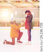 Купить «happy couple with engagement ring on skating rink», фото № 24236735, снято 26 ноября 2014 г. (c) Syda Productions / Фотобанк Лори