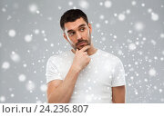 Купить «man thinking over snow background», фото № 24236807, снято 15 января 2016 г. (c) Syda Productions / Фотобанк Лори