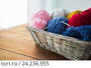 Купить «basket with knitting needles and balls of yarn», фото № 24236955, снято 20 октября 2016 г. (c) Syda Productions / Фотобанк Лори