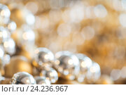 Купить «christmas balls decoration or beads bokeh», фото № 24236967, снято 3 ноября 2016 г. (c) Syda Productions / Фотобанк Лори