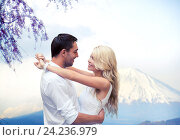 Купить «happy couple hugging over fuji mountain in japan», фото № 24236979, снято 14 июля 2013 г. (c) Syda Productions / Фотобанк Лори