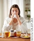 Купить «sick woman with medicine blowing nose to wipe», фото № 24237263, снято 13 октября 2016 г. (c) Syda Productions / Фотобанк Лори