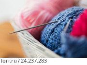 Купить «basket with knitting needles and balls of yarn», фото № 24237283, снято 20 октября 2016 г. (c) Syda Productions / Фотобанк Лори
