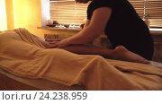 Купить «Massage legs of a young girl», видеоролик № 24238959, снято 20 октября 2019 г. (c) Raev Denis / Фотобанк Лори