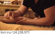Купить «Young man doing a foot massage indoors», видеоролик № 24238971, снято 23 октября 2019 г. (c) Raev Denis / Фотобанк Лори
