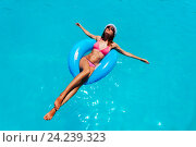 Купить «Happy attractive young woman swim in the pool», фото № 24239323, снято 25 июля 2015 г. (c) Сергей Новиков / Фотобанк Лори