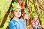 Cute boy in Injun's headdress playing with friends, фото № 24241731, снято 9 мая 2016 г. (c) Сергей Новиков / Фотобанк Лори