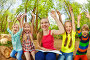 Group of happy kids reading a book in summer park, фото № 24241883, снято 9 мая 2016 г. (c) Сергей Новиков / Фотобанк Лори