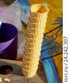 Купить «Вафельные стаканчики для мороженого», фото № 24242307, снято 21 августа 2016 г. (c) Павел Кулинич / Фотобанк Лори