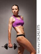 Купить «Confident healthy strong woman with dumbell», фото № 24242875, снято 19 июня 2016 г. (c) Сергей Новиков / Фотобанк Лори