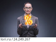 Купить «Businesswoman with percent sign in high interest concept», фото № 24249267, снято 20 августа 2016 г. (c) Elnur / Фотобанк Лори