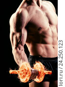 Купить «Muscular ripped bodybuilder with burning dumbbells», фото № 24250123, снято 14 мая 2015 г. (c) Elnur / Фотобанк Лори