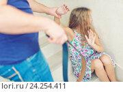 Купить «Домашнее насилие. Отец с ремнем и испуганная девочка», фото № 24254411, снято 23 октября 2016 г. (c) Наталья Дексбах / Фотобанк Лори