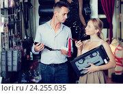 Купить «Man and woman choosing sexual accessories in sex shop», фото № 24255035, снято 23 марта 2019 г. (c) Яков Филимонов / Фотобанк Лори