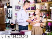 Купить «Couple choosing sex toy in sex shop», фото № 24255043, снято 23 марта 2019 г. (c) Яков Филимонов / Фотобанк Лори