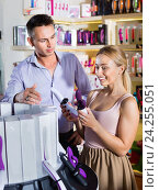 Купить «Portrait of adult couple choosing erotic toys», фото № 24255051, снято 23 марта 2019 г. (c) Яков Филимонов / Фотобанк Лори