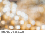 Купить «blurred golden christmas lights bokeh», фото № 24265223, снято 3 ноября 2016 г. (c) Syda Productions / Фотобанк Лори