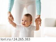 Купить «happy baby learning to walk with mother help», фото № 24265383, снято 12 июля 2016 г. (c) Syda Productions / Фотобанк Лори