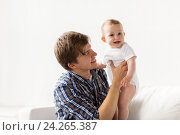 Купить «happy young father with little baby at home», фото № 24265387, снято 12 июля 2016 г. (c) Syda Productions / Фотобанк Лори