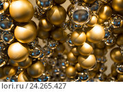Купить «golden christmas decoration or garland of beads», фото № 24265427, снято 3 ноября 2016 г. (c) Syda Productions / Фотобанк Лори