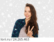 Купить «happy smiling teenage girl showing peace sign», фото № 24265463, снято 19 декабря 2015 г. (c) Syda Productions / Фотобанк Лори