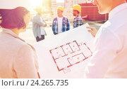 Купить «close up of architects with blueprint at building», фото № 24265735, снято 21 сентября 2014 г. (c) Syda Productions / Фотобанк Лори