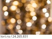 Купить «blurred golden christmas lights bokeh», фото № 24265831, снято 3 ноября 2016 г. (c) Syda Productions / Фотобанк Лори