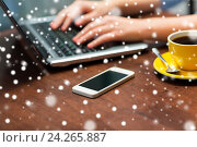 Купить «close up of smartphone and hands typing on laptop», фото № 24265887, снято 1 декабря 2015 г. (c) Syda Productions / Фотобанк Лори