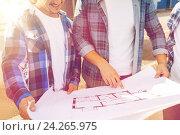 Купить «close up of smiling builders with blueprint», фото № 24265975, снято 21 сентября 2014 г. (c) Syda Productions / Фотобанк Лори