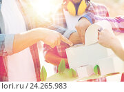 Купить «close up of builders with paper house model», фото № 24265983, снято 21 сентября 2014 г. (c) Syda Productions / Фотобанк Лори