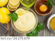 Купить «Майонез с оливковым маслом. Вид сверху», фото № 24275679, снято 24 ноября 2016 г. (c) Надежда Мишкова / Фотобанк Лори